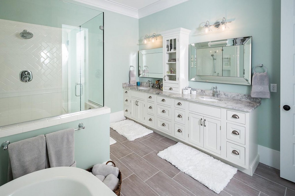 Beautifully designed new construction home features master bathroom including CliqStudios.com Austin inset-style cabinets in painted White to create furniture-style double vanity.